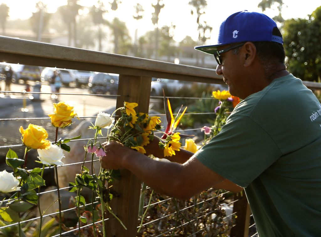 SANTA BARBARA, Sept. 3, 2019 - A man places flowers near the sea to pray for the boat fire victims in Santa Barbara, California, the United States, Sept. 2, 2019. In response to multiple U.S. media ...