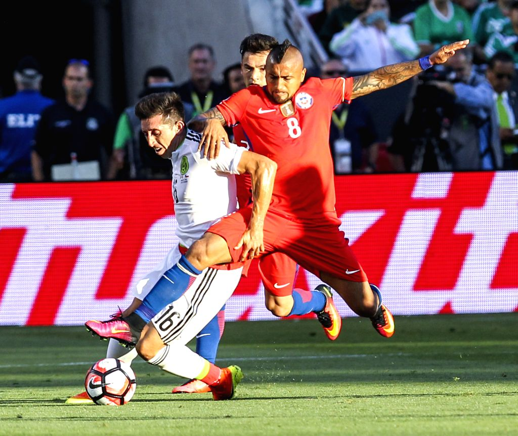 SANTA CLARA, June 19, 2016 - Arturo Vidal (R) of Chile vies with Hector Herrera of Mexico during their quarterfinal match of 2016 Copa America soccer tournament at the Levi's Stadium in Santa Clara, ...