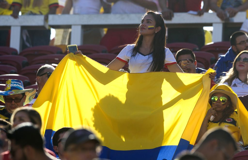SANTA CLARA, June 4, 2016 - A woman waves the national flag of Colombia during the opening ceremony of Copa America Centenario games at the Levi's Stadium in Santa Clara, California, the United ...