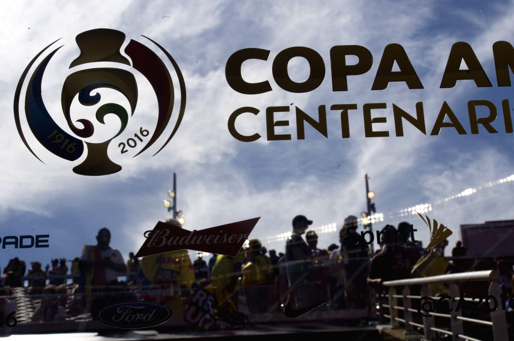 SANTA CLARA, June 4, 2016 - Spectators are reflected on a board with the sign of Copa America Centenario during the opening ceremony of Copa America Centenario games at the Levi's Stadium in Santa ...
