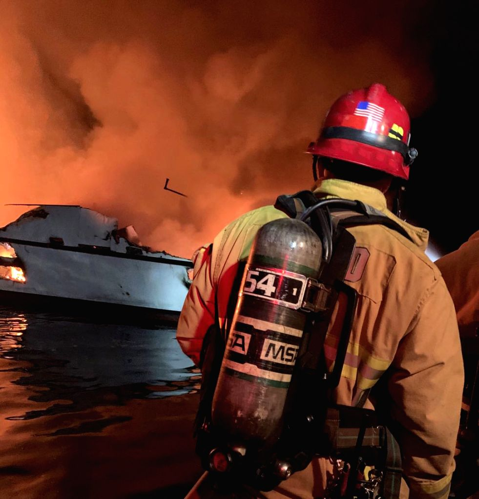 SANTA CRUZ ISLAND (U.S.), Sept. 2, 2019 A firefighter tries to extinguish a boat fire near Santa Cruz Island, California, the United States, on Sept. 2, 2019. A total of 34 people are ...