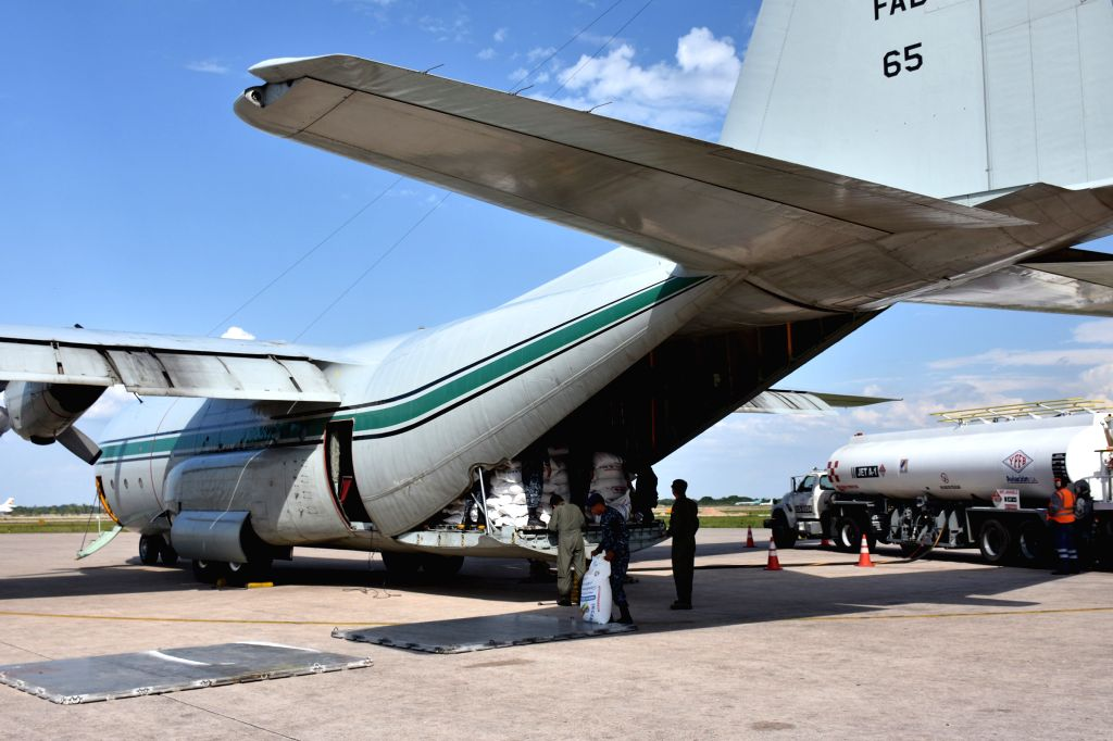 SANTA CRUZ, Oct. 9, 2016 - Bolivian military personnel load a plane with relief goods destined for hurricane-ravaged Haiti at an airport in Santa Cruz, Bolivia, on Oct. 8, 2016.