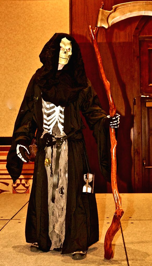 SANTA FE (U.S.), Oct. 27, 2019 A costumed participant poses at the Necro Nomic Con convention in Santa Fe of New Mexico, the United States, Oct. 26, 2019. The Necro Nomic Con is held here ...