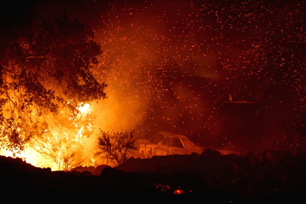 SANTA PAULA (U.S.), Dec. 5, 2017 (Xinhua) -- Photo taken on Dec. 5, 2017 shows a wildfire burning in Santa Paula, Ventura, the United States. Fast moving brush fire exploded to more than 10,000 acres (40 square km) Monday night in Ventura County in t