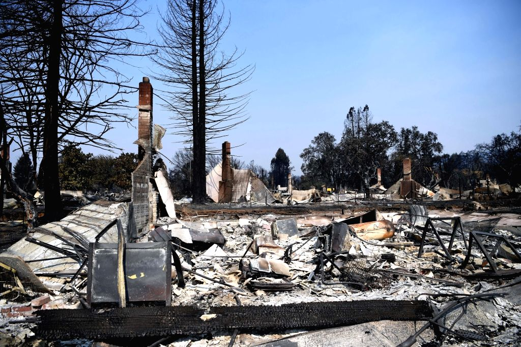 SANTA ROSA (U.S.), Oct. 14, 2017 Photo taken on Oct. 13, 2017 shows a burnt residential area in Santa Rosa, California, the United States. An estimated 5 percent of the housing stock, or ...
