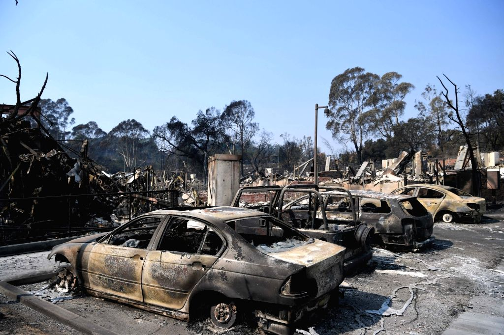 SANTA ROSA (U.S.), Oct. 14, 2017 Photo taken on Oct. 13, 2017 shows a burnt commercial district in Santa Rosa, California, the United States. An estimated 5 percent of the housing stock, ...