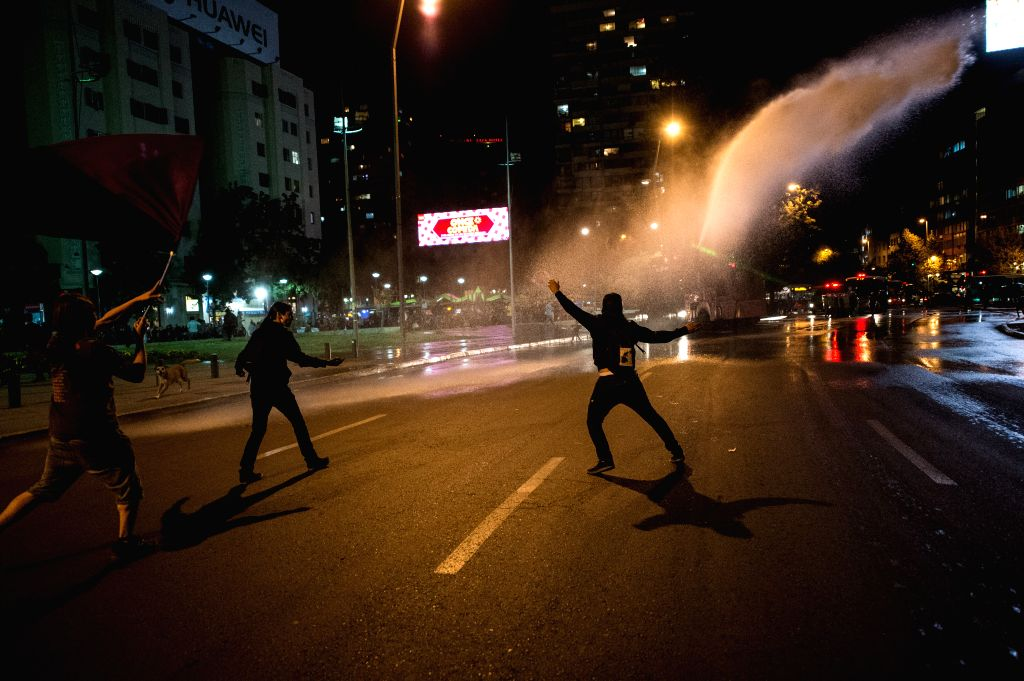 SANTIAGO, April 7, 2016 - A police vehicle sprays water to demostrators during a march in support of the Mapuche ethnic group in Santiago, capital of Chile, on April 6, 2016. According to local ...