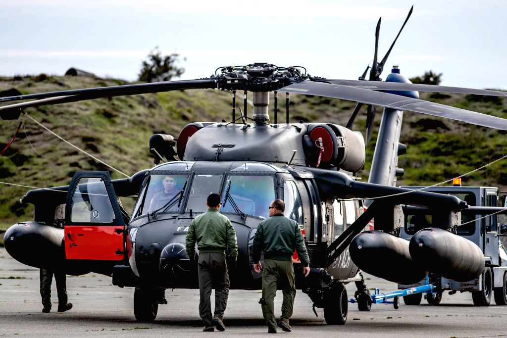 SANTIAGO, Dec. 12, 2019 - An aircraft prepares to conduct the search and rescue operation of the Chilean Air Force plane that vanished on Monday over the Antarctic, at the Chabunco air base in Chile, ...