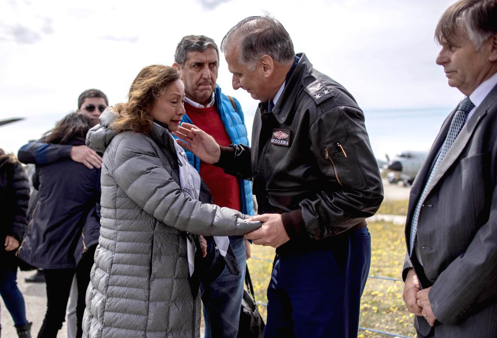 SANTIAGO, Dec. 12, 2019 - Relatives of people aboard the missing aircraft arrive at the Chabunco air base in Chile, Dec. 11, 2019. The Chilean Air Force reported that it lost track of a plane with 38 ...