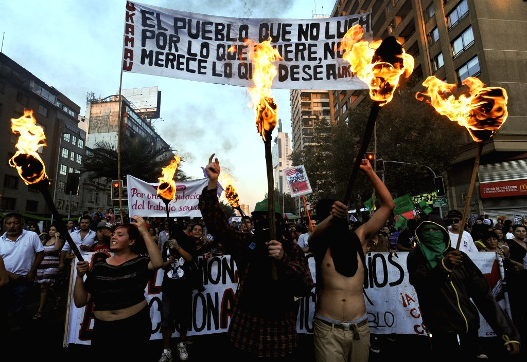 """People take part in a march called """"For a March 8 without clandestine abortions"""" to commemorate the International Women's Day, in Santiago, capital of ..."""