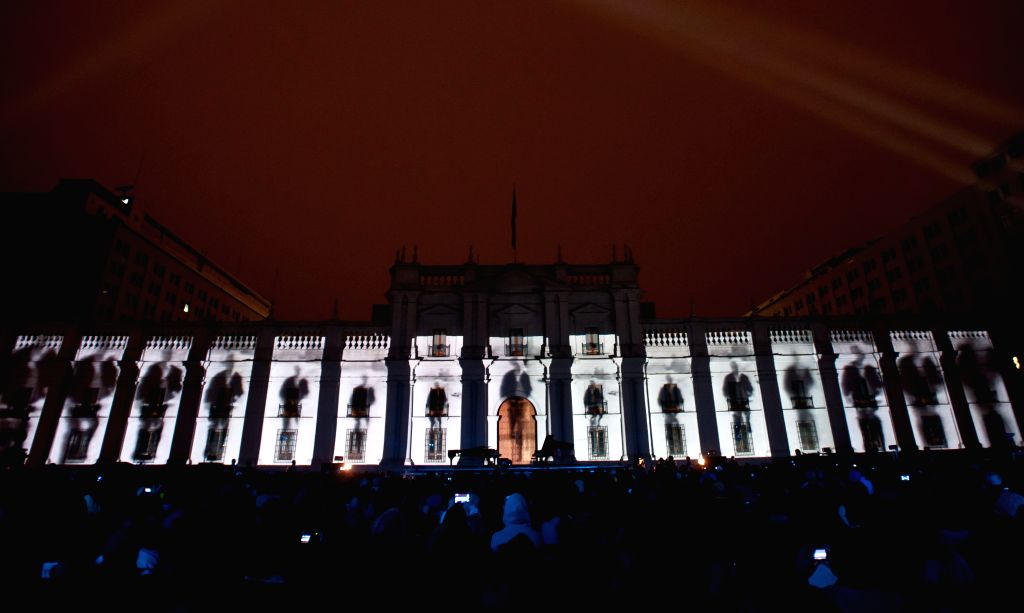 """People attend the homage to the so called Chilean """"anti-poet"""" Nicanor Parra, at La Moneda Palace square, in Santiago, capital of Chile, on Sept. 6, 2014."""