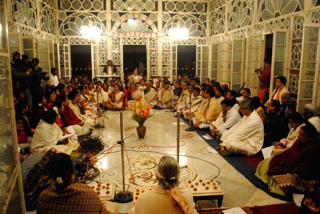 People participate in `Christo Utsav` a special prayer at Kach Mandir in Santiniketan, West Bengal on Dec 25, 2014.