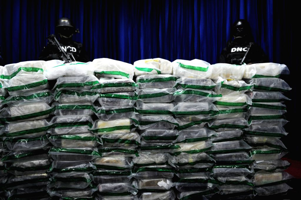 Agents of the National Drug Control (DNCD, for its acronym in Spanish) of the Dominican Republic guard packets of cocaine seized, during their presentation to