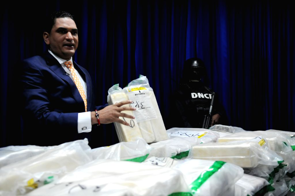National Drug Control (DNCD, for its acronym in Spanish) of the Dominican Republic spokeman, Miguel Medina shows packets of cocaine seized, during their ...