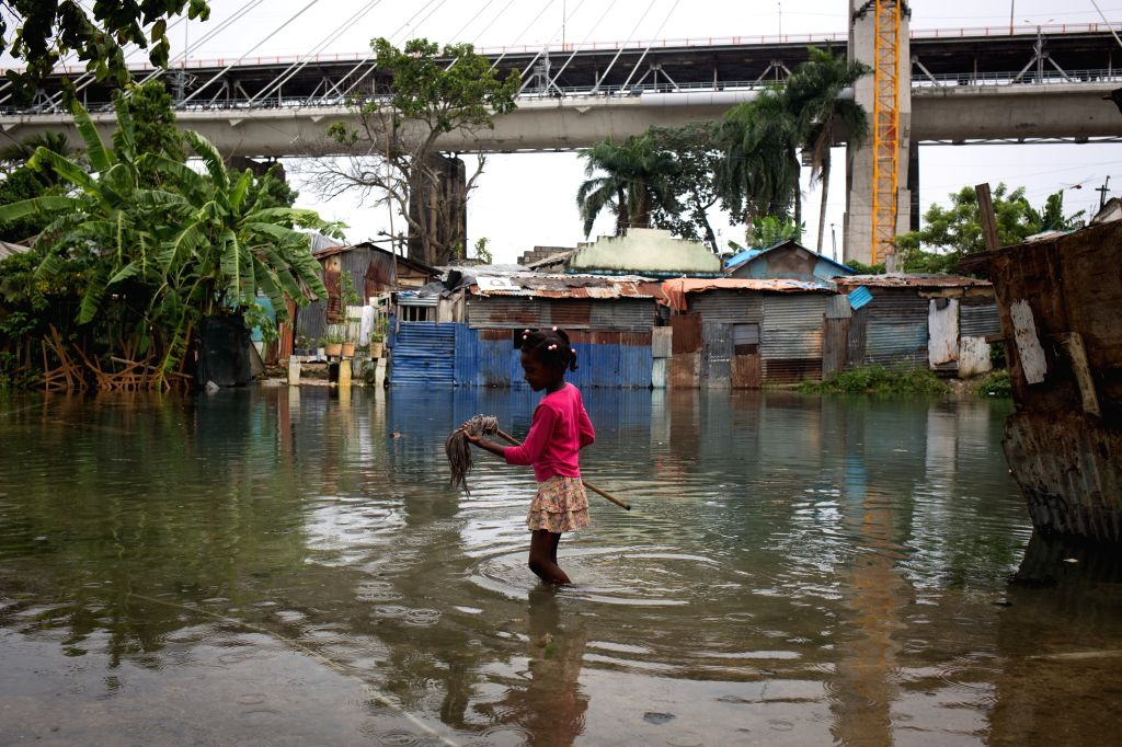 SANTO DOMINGO, Oct. 6, 2016 - Image provided by the United Nations Children's Fund (UNICEF) shows a girl walking on a flooded road after the pass of hurricane Matthew in Santo Domingo, capital of ...