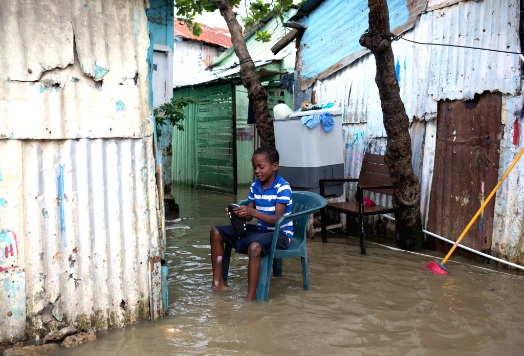 SANTO DOMINGO, Oct. 6, 2016 - Image provided by the United Nations Children's Fund (UNICEF) shows a boy sitting in front of his house after the pass of hurricane Matthew in Santo Domingo, capital of ...