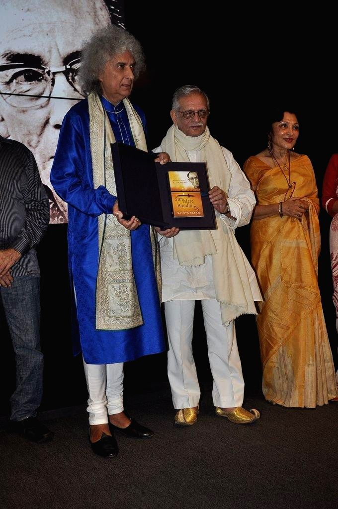 Santoor player Pandit Shiv Kumar Sharma, lyricist Gulzar and Author Sathya Saran during the book launch `Sun Mere Bandhu Re-The Musical World of S D Burman` by Sathya Saran in Mumbai, on August 8, ...