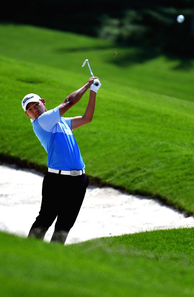 SANYA, Oct. 17, 2019 - Hak Shun Yat of China's Hong Kong hits during the first round match at the European Challenge Golf Tour 2019 Hainan Open in Sanya, south China's Hainan Province, on Oct. 17, ...