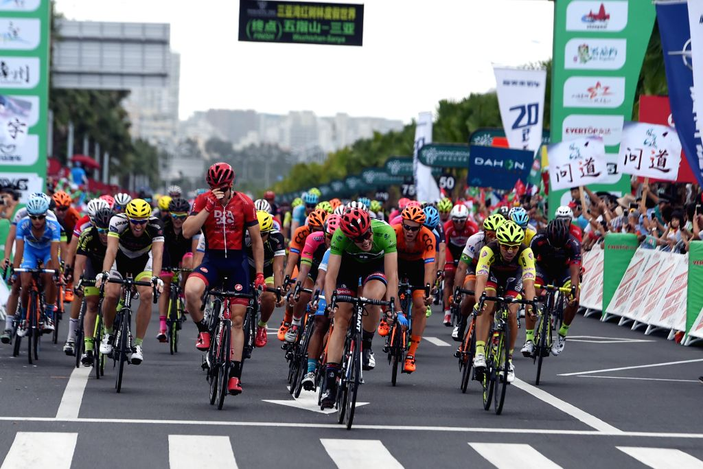 SANYA, Oct. 28, 2016 - Max Walscheid (Front) from Team Giant-Alpecin crosses the finish line during the 7th stage of the 2016 Tour of Hainan International Road Cycling Race in Sanya, south China's ...
