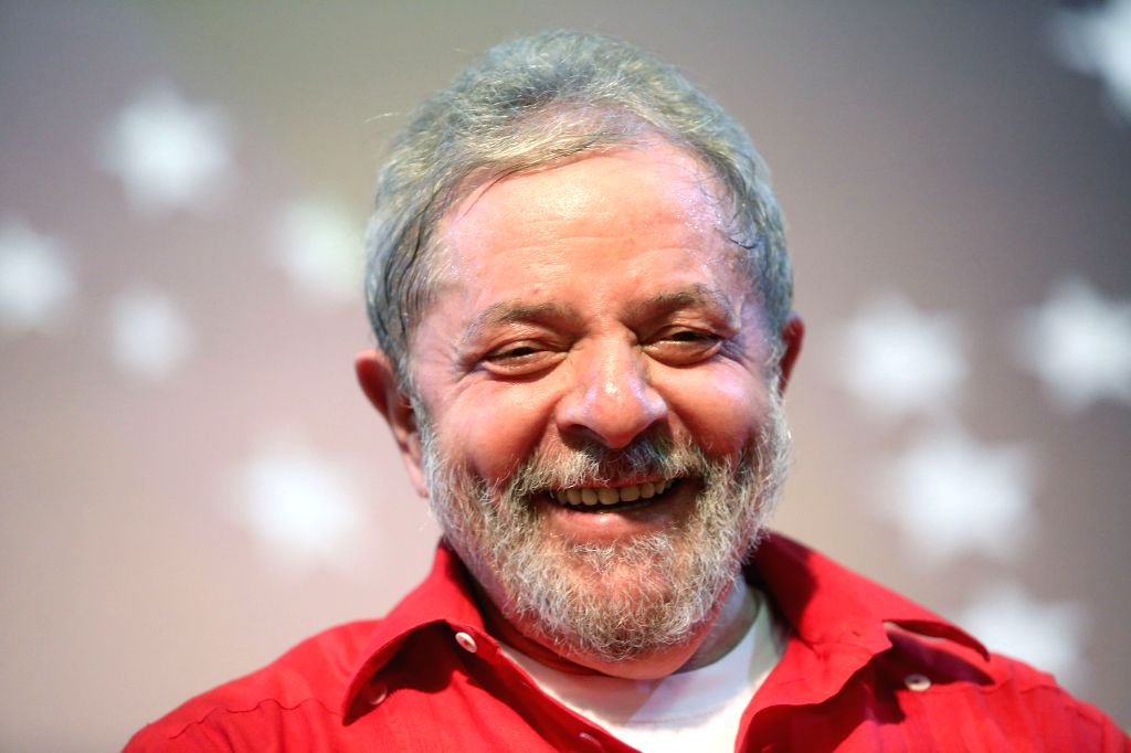 Brazil's former President Luiz Inacio Lula da Silva, reacts during a meeting with Brazilian unions and social movements pro-government, in the city of Sao Paulo, ...