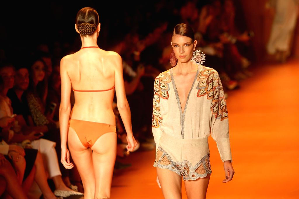 """Models present creations of the Summer Collection of """"Agua de Coco por Liana Thomaz"""", during the Sao Paulo's Fashion Week, in Sao Paulo, Brazil, on ..."""