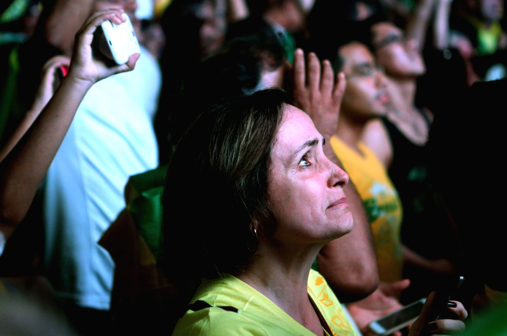 SAO PAULO, April 18, 2016 - A woman reacts while watching the live broadcast of the session's vote for the impeachment against Brazil's President Dilma Rousseff, in Sao Paulo, Brazil, on April 17, ...