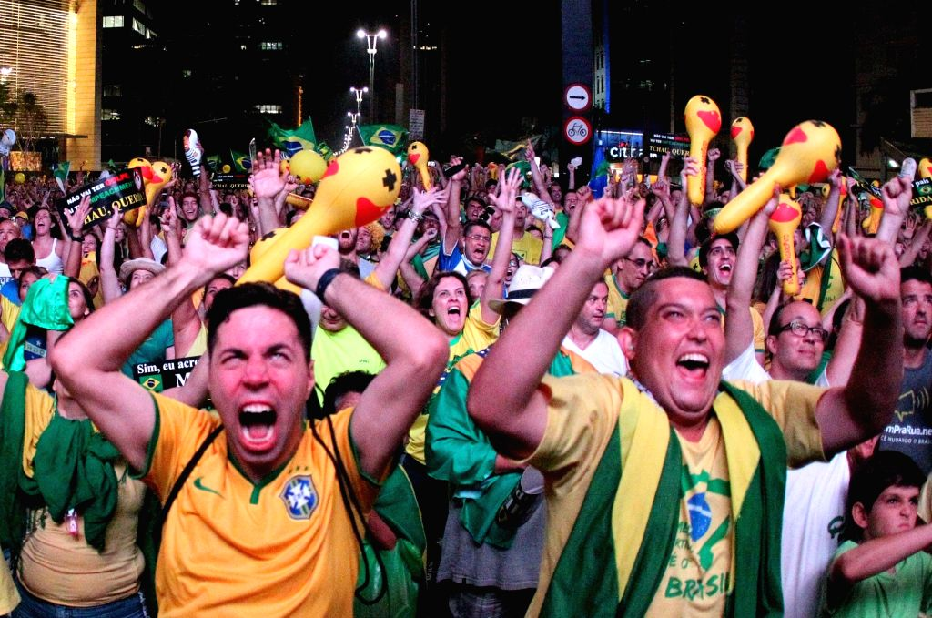 SAO PAULO, April 18, 2016 - People celebrate after the lower house of Congress voted to proceed with the impeachment of Brazil's President Dilma Rousseff, in Sao Paulo, Brazil, on April 17, 2016. The ...