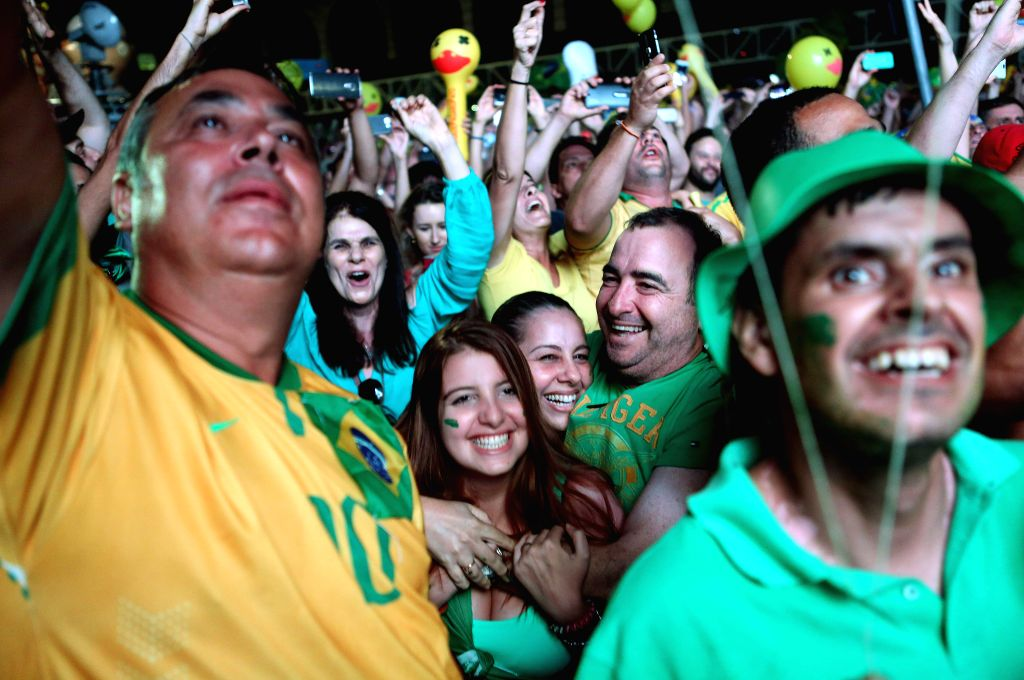 SAO PAULO, April 18, 2016 - People react while watching the live broadcast of the session's vote for the impeachment against Brazil's President Dilma Rousseff, in Sao Paulo, Brazil, on April 17, ...