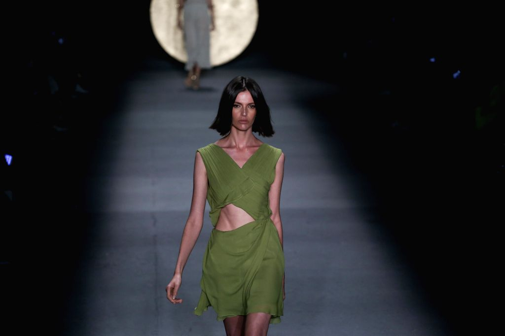 SAO PAULO, April 24, 2019 - A model presents a creation by Lilly Sarti during the Sao Paulo Fashion Week in Sao Paulo, Brazil, on April 23, 2019. The Sao Paulo Fashion Week is held here from April 22 ...
