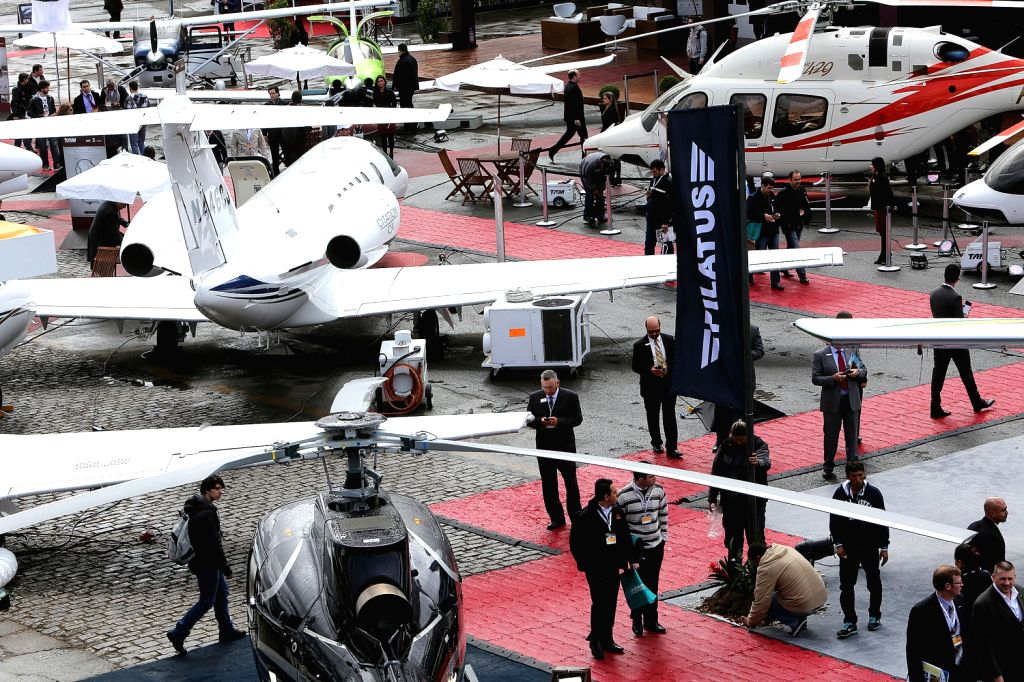 People look at aircraft on display during the Latin American Business Aviation Conference and Exhibition (LABACE), in Congonhas airport, in Sao Paulo, ...