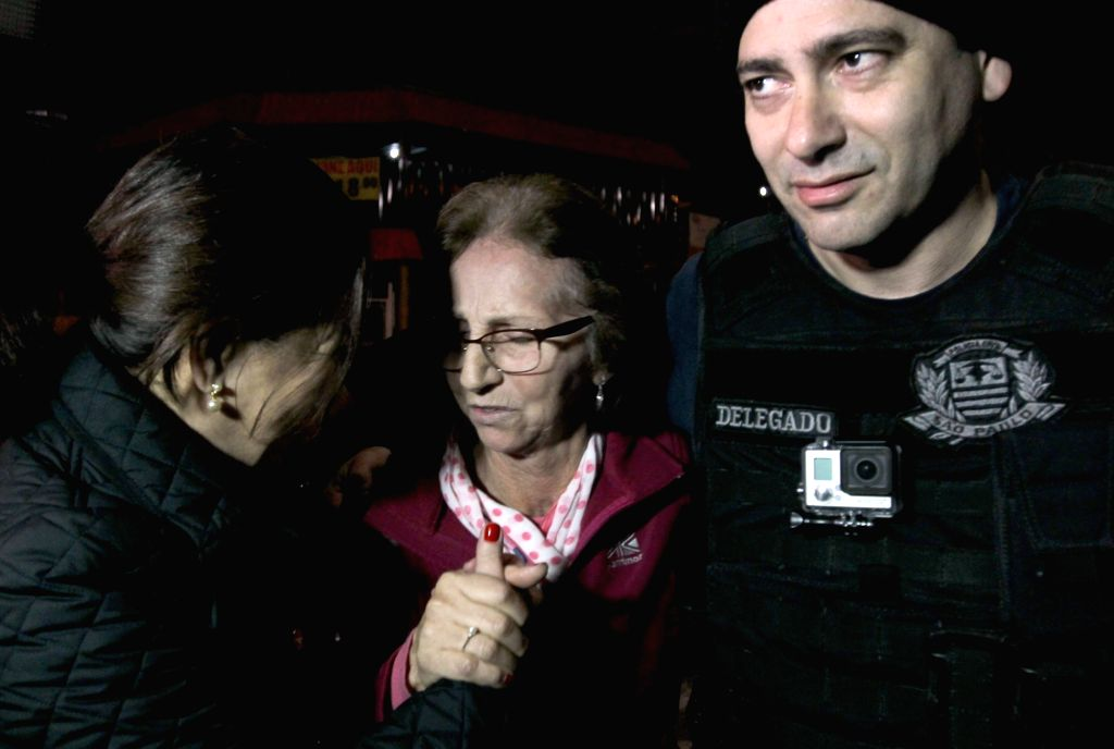 SAO PAULO, Aug. 2, 2016 - Aparecida Schunk Flosi Palmeira (C), mother-in-law of Formula One chief Bernie Ecclestone, arrives at the Homicide and People Protection Delegation of the Brazilian Police, ...