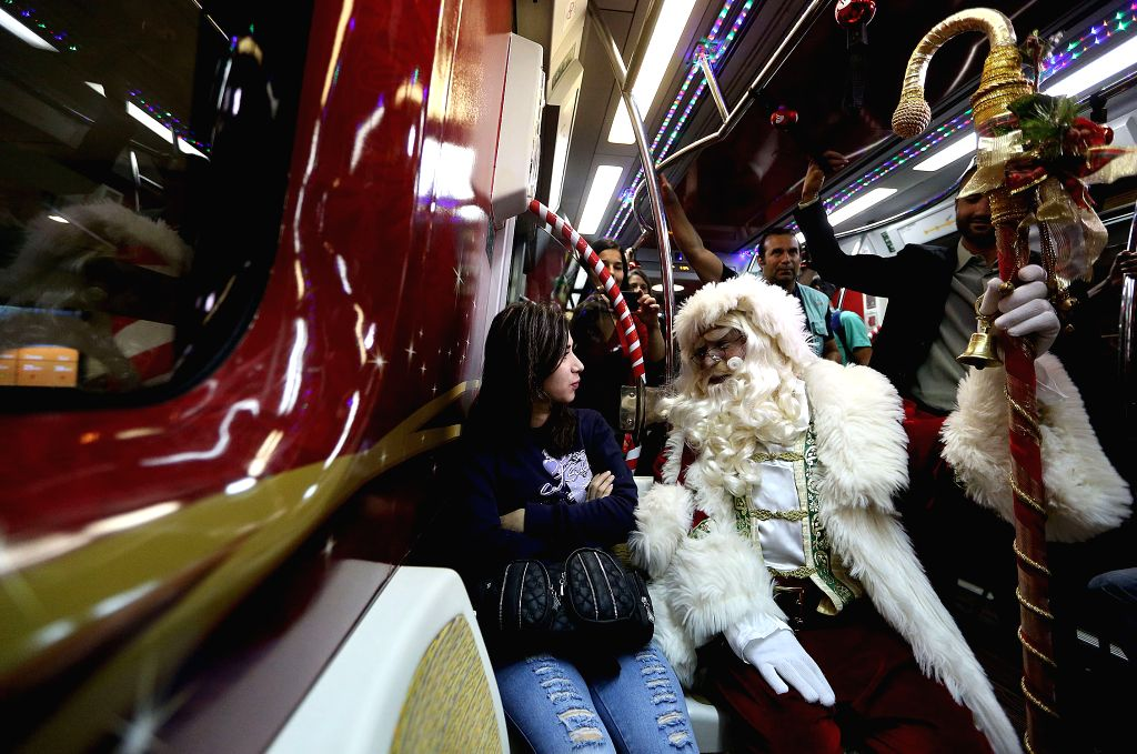 Sao Paulo (Brazil): An actor disguised as Santa Claus travels in a wagon of the Sao Paulo Metro Yellow Line, in the city of Sao Paulo, Brazil, on Dec. 1, 2014.