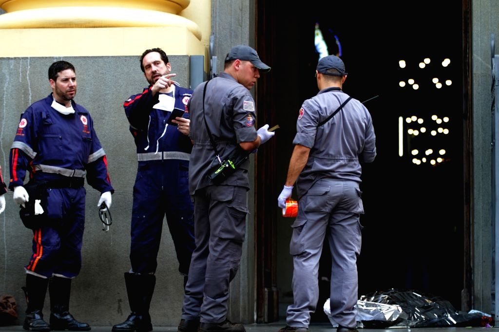 SAO PAULO (BRAZIL), Dec. 11, 2018 Members of rescue corps stand near a body after a shooting at the Campinas Cathedral in Sao Paulo state, Brazil, on Dec. 11, 2018. A gunman shot and ...