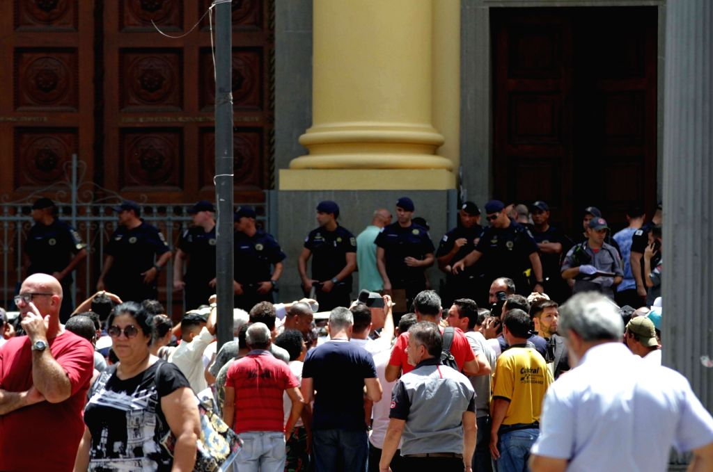 SAO PAULO (BRAZIL), Dec. 11, 2018 People gather outside the Campinas Cathedral after a shooting in Sao Paulo state, Brazil, on Dec. 11, 2018. A gunman shot and killed four people at a ...