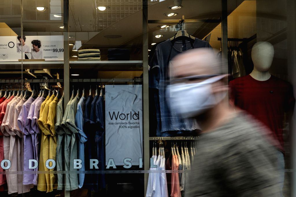 Sao Paulo (Brazil), Sept. 1, 2020 A pedestrian walks past a store in Sao Paulo, Brazil, on Sept. 1, 2020. Brazil's economy entered a technical recession after contracting 9.7 percent in ...