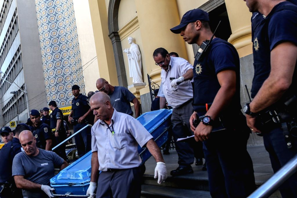 SAO PAULO, Dec. 11, 2018 - Municipal workers transfer the body of a victim from the Campinas Cathedral after a shooting in Sao Paulo state, Brazil, on Dec. 11, 2018. A gunman shot and killed four ...
