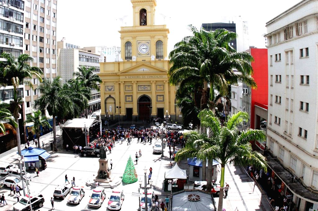 SAO PAULO, Dec. 11, 2018 - People gather outside the Campinas Cathedral after a shooting in Sao Paulo state, Brazil, on Dec. 11, 2018. A gunman shot and killed four people at a church in Brazil on ...