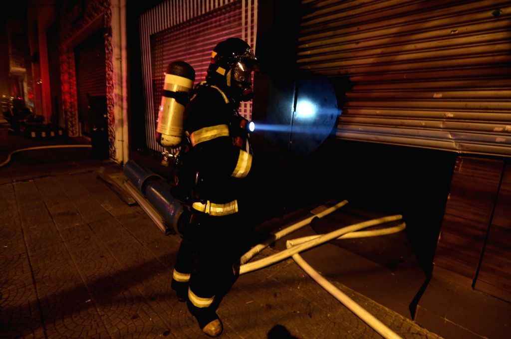 A fireman works at the site of a fire at a shopping mall in Sao Paulo, Brazil, on Dec. 21, 2014.  ...