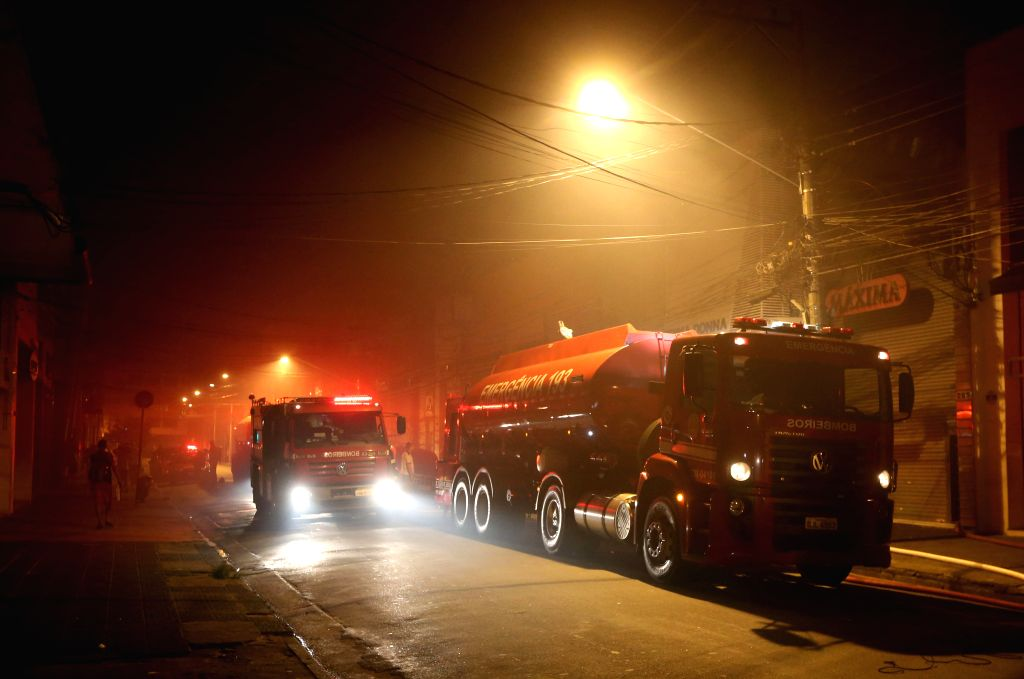 Fire engines arrive at the site of a fire at a shopping mall in Sao Paulo, Brazil, on Dec. 21, 2014.  ...