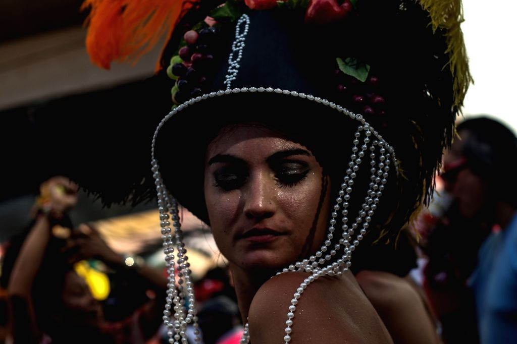 SAO PAULO, Feb. 25, 2019 - A reveler takes part in the carnival parade in Sao Paulo, Brazil, Feb. 24, 2019. The 17-day-long 2019 carnival season kicked off in Sao Paulo on Feb. 22 with a series of ...
