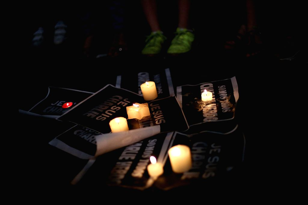 """People take part in a gathering mourning the people killed in an attack at the Paris offices of weekly newspaper """"Charlie Hebdo"""", in Sao Paulo, Brazil, .."""