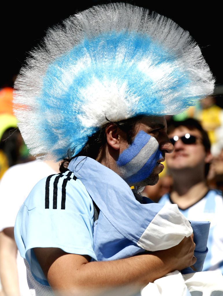 An Argentina's fan is seen before a Round of 16 match between Argentina and Switzerland of 2014 FIFA World Cup at the Arena de Sao Paulo Stadium in Sao Paulo, ...