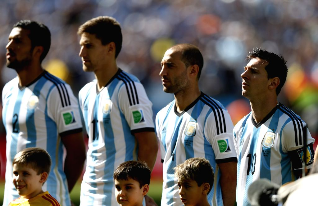 Argentina's Lionel Messi (1st R) attends the national anthem ceremony before a Round of 16 match between Argentina and Switzerland of 2014 FIFA World Cup at the ...