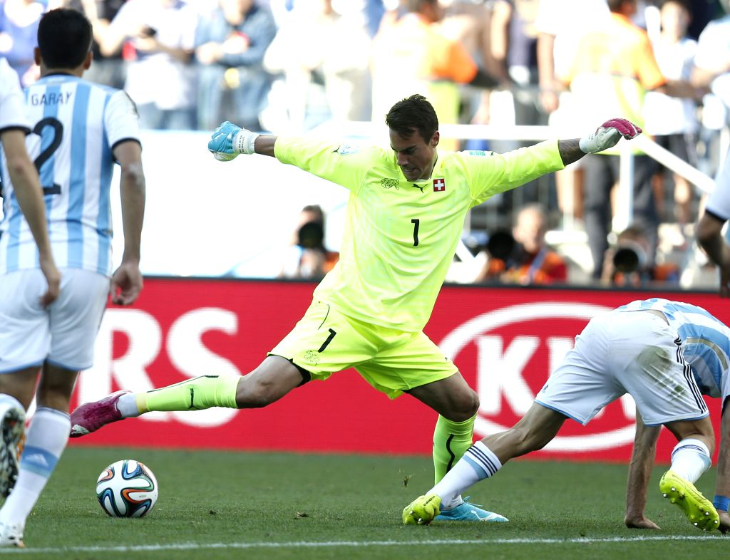 Switzerland's goalkeeper Diego Benaglio (C) controls the ball during a Round of 16 match between Argentina and Switzerland of 2014 FIFA World Cup at the Arena de ..