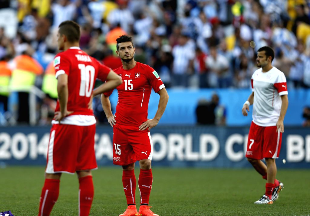 Switzerland's Blerim Dzemaili (C) reacts after a Round of 16 match between Argentina and Switzerland of 2014 FIFA World Cup at the Arena de Sao Paulo Stadium in ...
