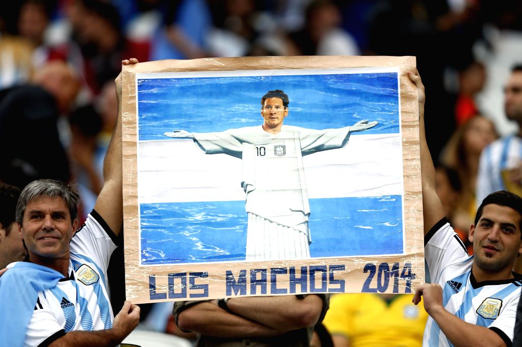Argentina's fans hold a banner of Argentina's Lionel Messi before a semifinal match between Netherlands and Argentina of 2014 FIFA World Cup at the Arena de Sao ...