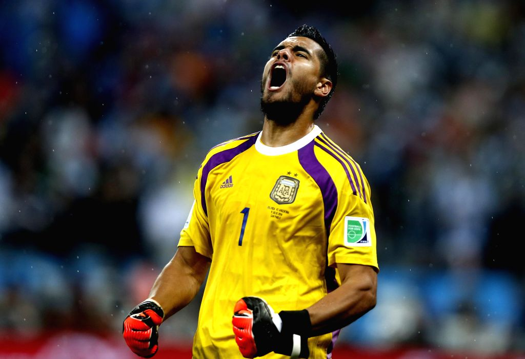 SAO PAULO, July 9, 2014 (Xinhua) -- Argentina's goalkeeper Sergio Romero reacts after saving a penalty kick by Netherlands' Ron Vlaar in the penalty shoot-out during a semifinal match between Netherlands and Argentina of 2014 FIFA World Cup at the Ar
