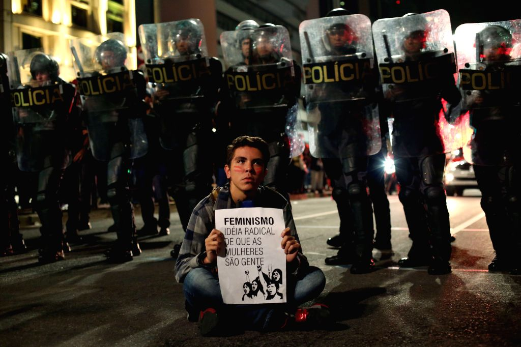 SAO PAULO, June 2, 2016 - A man holds a banner during a protest against the gang rape of a 16-year-old girl in Rio de Janeiro and violence against women, in Sao Paulo, Brazil, on June 1, 2016.