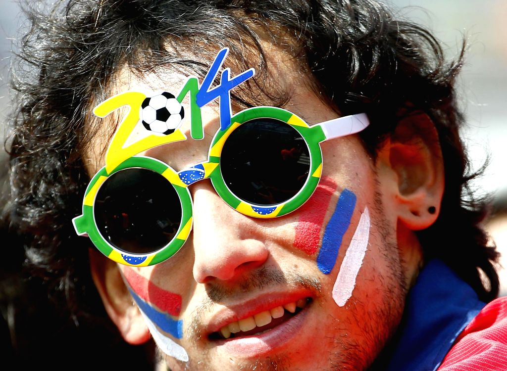 A supporter of Chile poses before a Group B match between Netherlands and Chile of 2014 FIFA World Cup at the Arena de Sao Paulo Stadium in Sao Paulo, Brazil, on ...