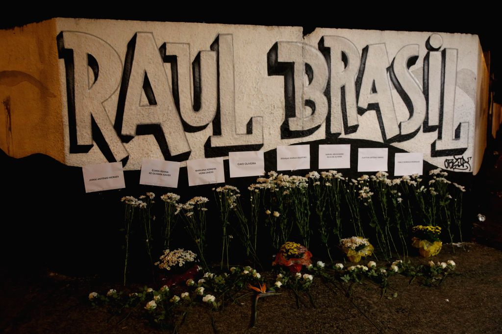 SAO PAULO, March 14, 2019 - People leave flowers for mourning outside the Raul Brasil Public School in Suzano, Sao Paulo, Brazil, on March 13, 2019. At least 10 people were killed and many more ...